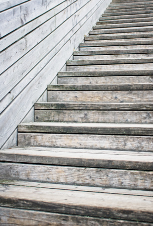 rise to the top: Part of a wooden staircase Stock Photo