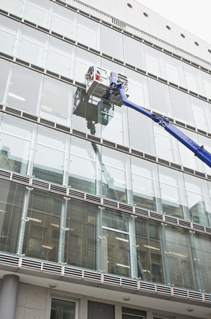 workmen: Workmen cleaning the outside of an office building Stock Photo