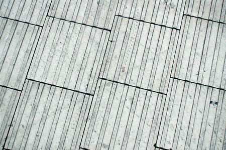 ridged: Square paving tiles as a background textured image