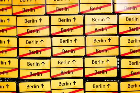 mauer: BERLIN, GERMANY - NOVEMBER 23 2015: Yellow souvenir fridge magnets on sale at a museum in Berlin