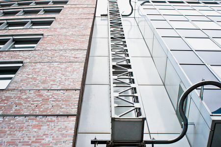 property berlin: An access ladder on the exteior of adjoining modern buildings in Germany Stock Photo