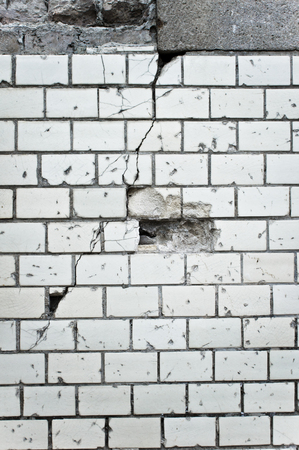 solid state: Part of a damaged white brick wall