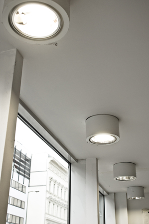 ceiling: Row of ceiling lights in a modern building