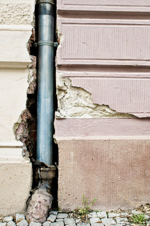 crack pipe: A drainpipe in a damaged strone wall
