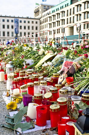 pay wall: BERLIN, GERMANY - NOVEMBER 23 2015: Floral tributes to the victims of the recent Paris attacks, near the French Embassy in Berlin. Editorial