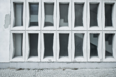 building sector: Glass panels in a stone wall, with stairs visible