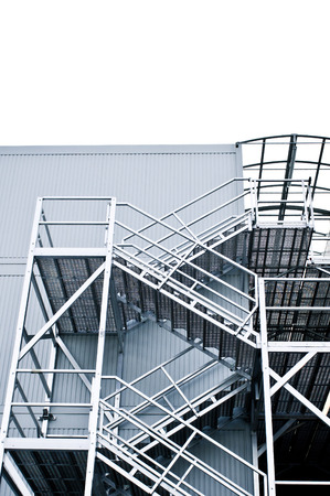 architectural firm: Metal stairs on the outside of a modern building