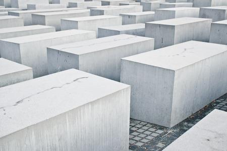 holocaust: BERLIN, GERMANY - NOVEMBER 23 2015: Large concrete blocks at the Holocaust Memorial in Berlin. Editorial