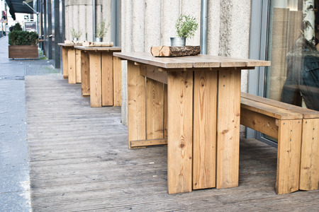 al fresco: Wooden benches and tables at a street cafe