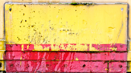 rustiness: Yellow and red painted metal surface as a background texture