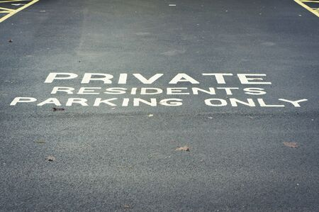 allocated on white: A painted sign for a residents only parking area
