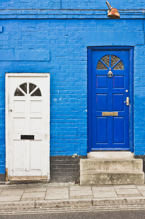 neighbouring: Adjoining town houses with white and blue front doors