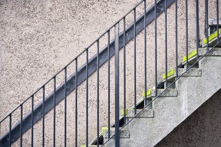 bannister: Part of a flight of stone steps against a stone wall Stock Photo