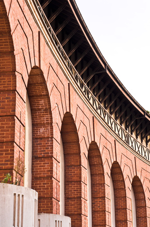 renovated: Part of the external wall of a renovated brick building in the UK with tall arches