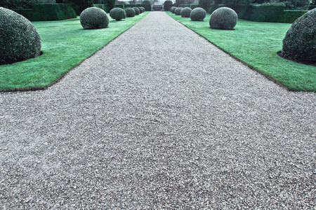 landscaped garden: A gravel path in a large landscaped garden in the UK Stock Photo