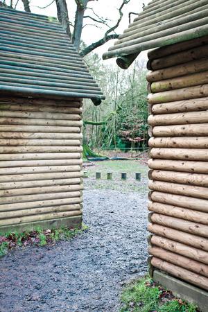 adjacent: Adjacent wooden log cabins in the woodland