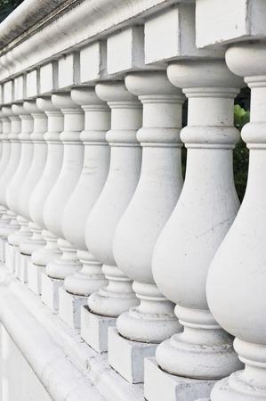 balustrade: A white stone wall with balustrade pillars