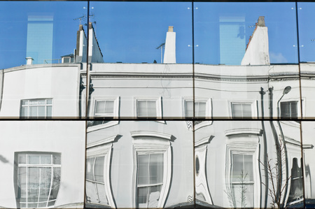townhouses: A row of townhouses reflected in glass panels