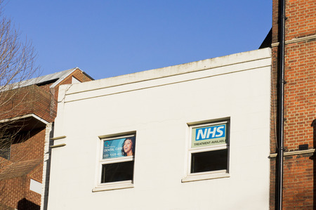 funded: LONDON, UK - JANUARY 30 2016: The exterior of a dental centre in London offering treatment under the national health service.