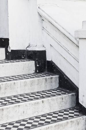 chequer: Steps at the entrance to a house with decorative black and white tiles