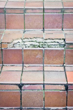 concrete steps: Broken terracotta tiles covering concrete steps