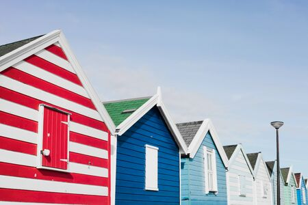 sripes: A row of colourful beach huts in Southwold, UK Stock Photo