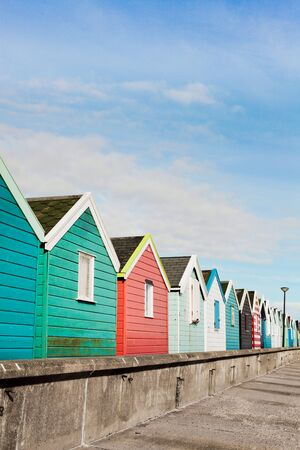 southwold: A row of colourful beach huts in Southwold, UK Stock Photo