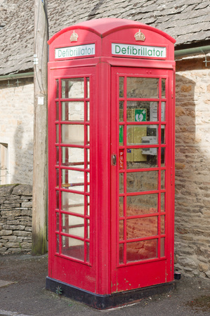 slaughter: UPPER SLAUGHTER, UK - MARCH 25 2016: A classic british red phone box has been converted to a defibrillator facility in a village which is frequented by tourists.