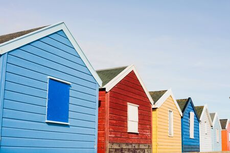 A row of colourful beach huts in Southwold, UK Stock Photo