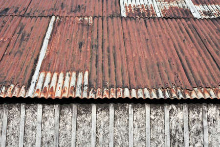 outbuilding: A markedly rusty metal roof on an old shed