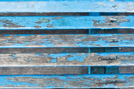 timber bench seat: Part of a blue wooden bench with peeling paint Stock Photo