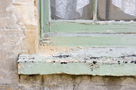 Part of the exterior of a window frame with signs of weathering Stock Photo
