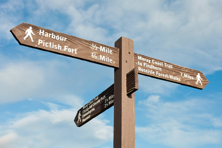 wooden trail sign: A wooden signpost in Burghead, Scotland, indicating visitor sites