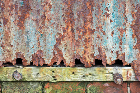 severely: Severely rusted corrugated metal in close up Stock Photo