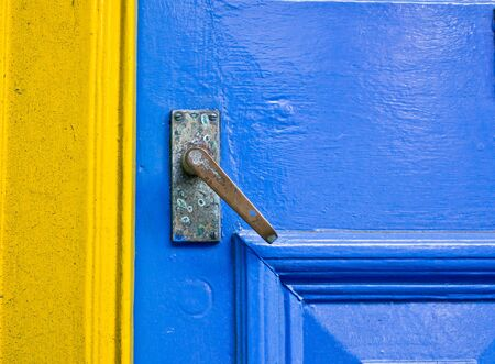 secret place: A blue door next to a yellow frame Stock Photo