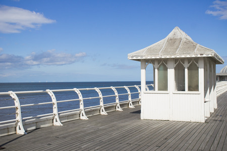 seating: Part of a pier in England with a seating shelter