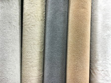 homeware: A selection of carpet rolls in a homeware store Stock Photo
