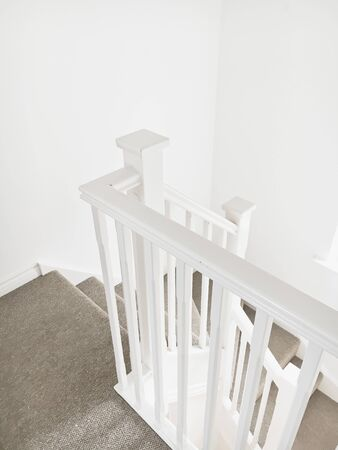 bannister: Part of a white wooden bannister in a modern home Stock Photo