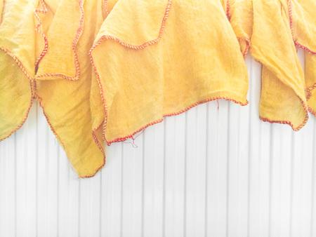 mundane: Yellow dusting cloths drying on a radiator Stock Photo