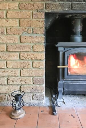 wood burning stove: Part of a wood burning stove in a brick wall