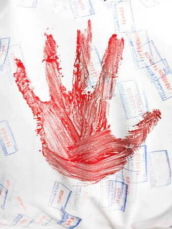 bloody hand print: A red hand print on a white textile