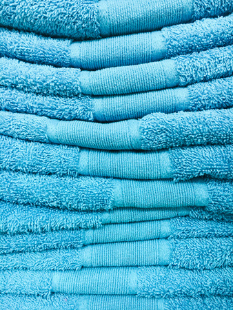 A stack of blue towels as a background Stock Photo