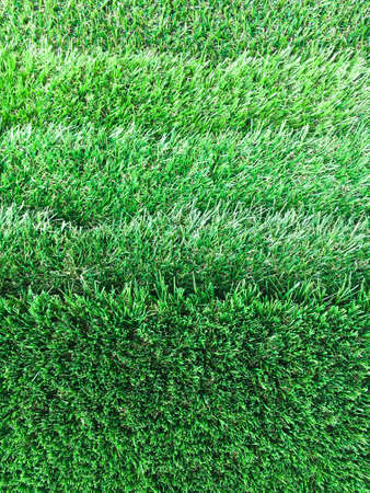 manmade: Sheets of artifical grass as a background