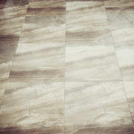 muted: Marble floor tiles, squared image, muted retro filter Stock Photo