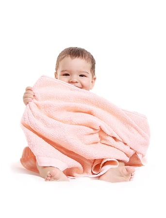 Baby boy playing with pink towel - isolated Stock Photo