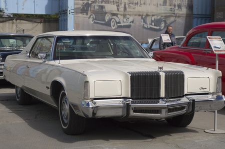 presented: YEKATERINBURG, RUSSIA - AUGUST 16, 2015: American retro car Chrysler New Yorker 1976 presented at the exhibition in retro Russian city of Yekaterinburg.