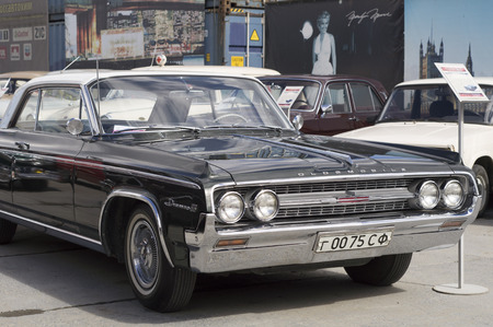 presented: YEKATERINBURG, RUSSIA - AUGUST 16, 2015: American retro car Oldsmobile 88 presented at the exhibition in retro Russian city of Yekaterinburg.