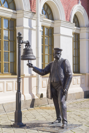 superintendent: YEKATERINBURG, RUSSIA - AUGUST 01, 2015: Sculpture The Stationmaster installed near the train station in the city of Yekaterinburg Editorial