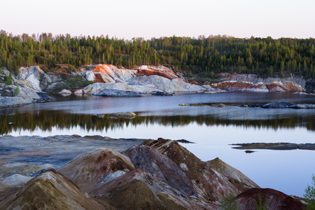 unearthly: Unearthly landscape in the clay quarry on a summer evening