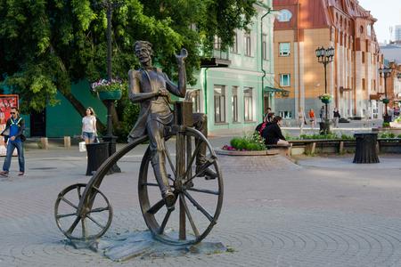 workmanship: Yekaterinburg Russia - July 10, 2016: The bronze sculpture of the inventor of the bike Artamonov set on the street Weiner in Yekaterinburg.